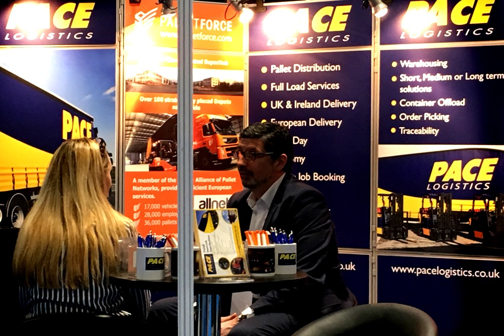 Discussing Pallet Distribution at Manchester Exhibition