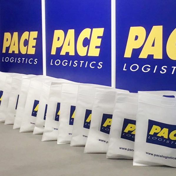 Pace Logistics bags of promotional items ready to distribute at The Northern Business Exhibition Manchester.